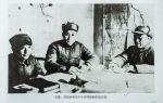 朱德、刘伯承和邓小平共同研究作战计划。